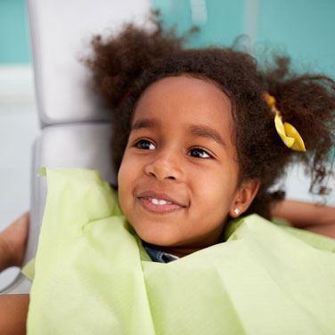 Smiling kid at dental chair