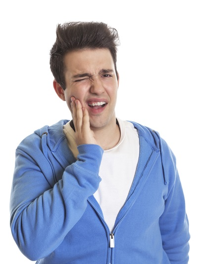 Man with tooth pain holding cheek needing a root canal by Spokane Dentist, Henning Dental Studio and Dr. Marc Henni